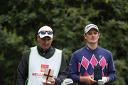Justin Rose of England waits with caddy Mark Fulcher during the second round of the Wells Fargo Championship at the Quail Hollow Club on May 2, 2014 in Charlotte, North Carolina.