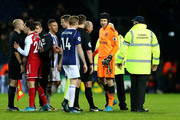 Petr Cech, goalkeeper of Arsenal have words with referee Mike Dean after the final whistle during the Premier League match between West Bromwich Albion and Arsenal at The Hawthorns on December 31, 2017 in West Bromwich, England.