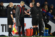 Arsene Wenger the Manager of Arsenal has a word with Referee Mike Dean during the Premier League match between West Bromwich Albion and Arsenal at The Hawthorns on December 31, 2017 in West Bromwich, England.