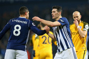 Jake Livermore of West Bromwich Abion  and Gareth Barry of West Bromwich Albion embrace after the Premier League match between West Bromwich Albion and Brighton and Hove Albion at The Hawthorns on January 13, 2018 in West Bromwich, England.