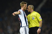 Darren Fletcher of West Bromwich Albion talks with referee Mike Dean during the Barclays Premier League match between West Bromwich Albion and A.F.C. Bournemouth at The Hawthorns on December 19, 2015 in West Bromwich, England.