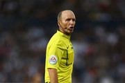 Referee Mike Dean during the Barclays Premier League match between West Bromwich Albion and Manchester City at The Hawthorns on August 10, 2015 in West Bromwich, England.