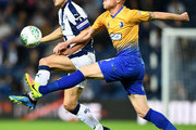 Gareth Barry of West Bromwich Albion Neal Bishop of Mansfield Town during the Carabao Cup Second Round match between West Bromwich Albion and Mansfield Town at The Hawthorns on August 28, 2018 in West Bromwich, England.
