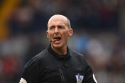 Referee Mike Dean looks on during the Barclays Premier League match between West Bromwich Albion and West Ham United at The Hawthorns on April 26, 2014 in West Bromwich, England.
