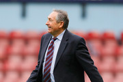 Aston Villa manager Gerard Houllier smiles at the fans as he celebrates victory in the Barclays Premier League match between West Ham United and Aston Villa at the Boleyn Ground on April 16, 2011 in London, England.