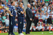 West Ham United manager Avram Grant (C) looks thoughtful as Blackburn Rovers manager Steve Kean shouts directs to his team during the Barclays Premier League match between West Ham United and Blackburn Rovers at the Boleyn Ground on May 7, 2011 in London, England.