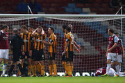 Nikica Jelavic of Hull City appeals to Referee Mike Dean after West Ham were awarded a penalty for a foul on Mohamed Diame of West Ham during the Barclays Premier League match between West Ham United and Hull City at Boleyn Ground on March 26, 2014 in London, England.