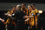 Alex Bruce, Tom Huddlestone and James Chester of Hull City appeal to Referee Mike Dean after he awarded West Ham a penalty during the Barclays Premier League match between West Ham United and Hull City at Boleyn Ground on March 26, 2014 in London, England.