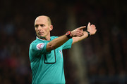 Referee Mike Dean during the Barclays Premier League match between West Ham United and Newcastle United at Boleyn Ground on November 29, 2014 in London, England.