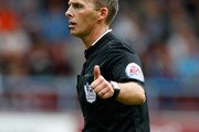 Referee Mike Dean in action during the Barclays Premier League match between West Ham United and Southampton at Boleyn Ground on August 30, 2014 in London, England.