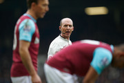 Referee Mike Dean during the Barclays Premier League match between West Ham United and Sunderland at the Boleyn Ground on 27 February, 2016 in London, England.