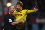 Sebastian Prodl of Watford conftonts Referee Mike Dean during the Barclays Premier League match between West Ham United and Watford at the Boleyn Ground, April 20, 2016, London, England