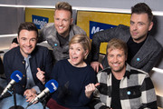 Shane Filan (L), Nicky Byrne (2nd L), Kian Egan (2nd R) and Mark Feehily (R) of Westlife, pictured with Emma B (3rd R), visit Magic Radio on January 09, 2019 in London, England.