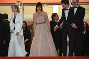 "Rodica Lazar, Catrinel Marlon, Sabin Tambrea and Corneliu Porumboiu depart the screening of ""The Whistlers (La Gomera/ Les Siffleurs)"" during the 72nd annual Cannes Film Festival on May 18, 2019 in Cannes, France."