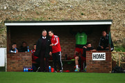 Whitehawk Manager Steve King (l) looks on during the Emirates FA Cup First Round match between Whitehawk FC and Lincoln City at The Enclosed Ground on November 8, 2015 in Brighton, England.
