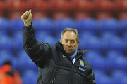 Villa manager Gerard Houllier salutes the fans after winning the Barclays Premier League match between Wigan Athletic and Aston Villa at the DW Stadium on January 25, 2011 in Wigan, England.