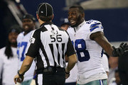 Dez Bryant #88 of the Dallas Cowboys argues with side judge Allen Baynes #56 after a penatly was called against Anthony Hitchens #59 of the Dallas Cowboys when he collided with Brandon Pettigrew #87 of the Detroit Lions on a pass play during the second half of their NFC Wild Card Playoff game at AT&T Stadium on January 4, 2015 in Arlington, Texas.