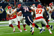Josh Mauga #90 of the Kansas City Chiefs returns an interception against Chris Clark #74 of the Houston Texans in the second quarter during the AFC Wild Card Playoff game at NRG Stadium on January 9, 2016 in Houston, Texas.