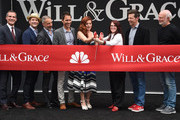 (L-R) Eric Garcetti, Max Mutchnick, David Kohan, Eric McCormack, Debra Messing, Megan Mullally and Sean Hayes attend the ribbon cutting ceremony for 'Will & Grace' start of production kick-off at the Universal studios stage 22 in Los Angeles on August 2, 2017. / AFP PHOTO / CHRIS DELMAS