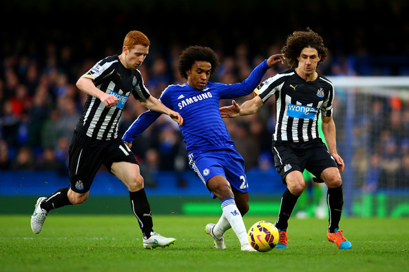 Chelsea v Newcastle United - Premier League [player,sports,soccer player,sports equipment,football player,soccer,team sport,ball game,football,sport venue,willian,jack colback,fabricio coloccini,ball,stamford bridge,newcastle united,chelsea,premier league,battles,match]