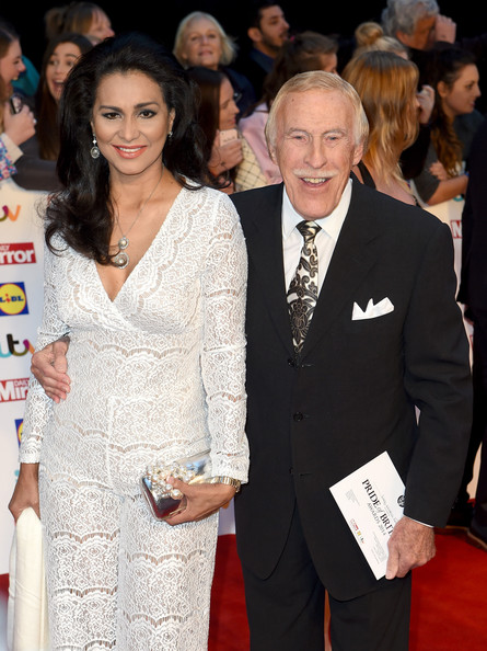 Pride of Britain Awards [bruce forsyth,wilnelia forsyth,r,pride of britain awards,awards,pride of britain,event,red carpet,carpet,suit,fashion,premiere,flooring,formal wear,smile,award ceremony,england,london,grosvenor house hotel]