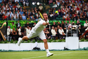 Lleyton Hewitt of Australia returns a shot during his men's doubles match between Jamie Murray of Great Britain and Goran Ivanisevic of Croatia and Lleyton Hewitt of Australia and Pat Cash of Australia during the Wimbledon No. 1 Court Celebration in support of the Wimbledon Foundation at All England Lawn Tennis and Croquet Club on May 19, 2019 in London, England.