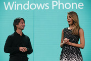 Microsoft Corporate Vice President Joe Belfiore (L) listens as actress Jessica Alba speaks during a Windows Phone 8 product launch at Bill Graham Civic Auditorium on October 29, 2012 in San Francisco, California. The Windows Phone 8 marks the Seattle-based company's latest update from its two-year-old Windows Phone 7 platform as the company looks to regain its traction in the increasingly dense smartphone segment dominated by rivals Apple and Google.