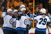 Paul Stastny #25, Nikolaj Ehlers #27, Tyler Myers #57, and Patrik Laine #29 celebrate a goal against the Nashville Predators during the first period in Game Seven of the Western Conference Second Round during the 2018 NHL Stanley Cup Playoffs at Bridgestone Arena on May 10, 2018 in Nashville, Tennessee.