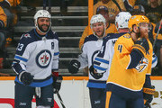 Dustin Byfuglien #33, Paul Stastny #25 and Josh Morrissey #44 of the Winnipeg Jets celebrate after a goal against Ryan Ellis #4 of the Nashville Predators during the first period in Game Two of the Western Conference Second Round during the 2018 NHL Stanley Cup Playoffs at Bridgestone Arena on April 29, 2018 in Nashville, Tennessee.
