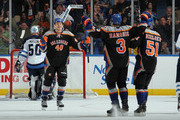 Michael Grabner #40 of the New York Islanders celebrates his game winning goal at 19:13 of the third period against Chris Mason #50 of the Winnipeg Jets at the Nassau Veterans Memorial Coliseum on April 5, 2012 in Uniondale, New York. The Islanders defeated the Jets 5-4.