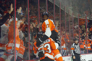 Claude Giroux #28, Wayne Simmonds #17 and Shayne Gostisbehere #53 of the Philadelphia Flyers celebrate the game winning goal against the Winnipeg Jets at the Wells Fargo Center on March 28, 2016 in Philadelphia, Pennsylvania. The Flyers defeated the Jets 3-2 in overtime.