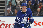Tyler Bozak #42 of the Toronto Maple Leafs skates with the puck against the Winnipeg Jets during an NHL game at the Air Canada Centre on March 31, 2018 in Toronto, Ontario, Canada. The Jets defeated the Maple Leafs 3-1. (Photo by Claus Andersen/Getty Images) *** Local Caption *** Tyler Bozak