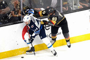 Josh Morrissey #44 of the Winnipeg Jets is checked by Tomas Tatar #90 of the Vegas Golden Knights during the first period in Game Three of the Western Conference Finals during the 2018 NHL Stanley Cup Playoffs at T-Mobile Arena on May 16, 2018 in Las Vegas, Nevada.