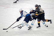 Tomas Tatar #90 of the Vegas Golden Knights collides with Josh Morrissey #44 as Brandon Tanev #13 of the Winnipeg Jets skates away with the puck during the first period in Game Three of the Western Conference Finals during the 2018 NHL Stanley Cup Playoffs at T-Mobile Arena on May 16, 2018 in Las Vegas, Nevada.