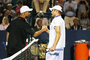 Andy Roddick of the USA is congratulated by James Blake also of the USA after being defeated in straight sets 7-6, 7-6 during the Winston-Salem Open at the Wake Forest University Tennis Complex on August 20, 2012 in Winston-Salem, North Carolina.