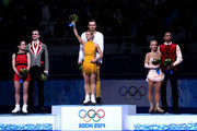 (L-R) Silver medalists Ksenia Stolbova and Fedor Klimov of Russia, gold medalists Tatiana Volosozhar and Maxim Trankov of Russia, bronze medalists Aliona Savchenko and Robin Szolkowy of Germany celebrate on the podium during the flower ceremony for the Figure Skating Pairs event during day five of the 2014 Sochi Olympics at Iceberg Skating Palace on February 12, 2014 in Sochi, Russia.