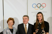 President of the International Olympic Committee (IOC), Thomas Bach (C) and his wife Claudia pose with Olympic Village Mayor and Russian pole vault champion Yelena Isinbayeva, before the IOC Gala Dinner on the eve of the Sochi 2014 Winter Olympics on February 6, 2014 in Sochi, Russia.