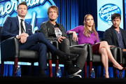 """(L-R) Ryan Seacrest, Keith Urban, Jennifer Lopez, and Harry Connick, Jr., of the television show """"American Idol"""" speak during the FOX portion of the 2014 Television Critics Association Press Tour at the Langham Hotel on January 13, 2014 in Pasadena, California."""
