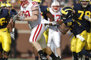 Denard Robinson and J.J. Watt Photos Photo