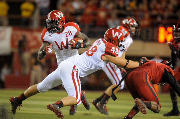 Running back Montee Ball #28 of the Wisconsin Badgers avoids members of the Nebraska Cornhuskers defense with help from teammate tight end Jacob Pedersen #48 during their game at Memorial Stadium on September 29, 2012 in Lincoln, Nebraska.