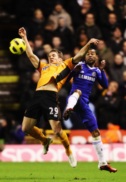 Kevin Doyle (L) of Wolverhampton Wanderers and Ashley Cole (R) of Chelsea challenge for the ball during the Barclays Premier League match between Wolverhampton Wanderers and Chelsea at Molineux on January 5, 2011 in Wolverhampton, England.