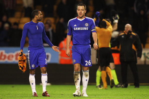 Ashley Cole (L) and John Terry (R) of Chelsea talk following their sides defeat during the Barclays Premier League match between Wolverhampton Wanderers and Chelsea at Molineux on January 5, 2011 in Wolverhampton, England.