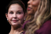 Actress and activist Ashley Judd (L) looks on as Adama Iwu speaks during the 29th annual Conference of the Professional Businesswomen of California (PBWC) on April 24, 2018 in San Francisco, California. The PBWC is a day of keynote speakers and seminars by top female leaders and panels of industry experts.