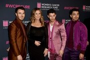 Rita Wilson (2nd from L) with Nick Jonas, Kevin Jonas, and Joe Jonas of Jonas Brothers attend The Women's Cancer Research Fund's 'An Unforgettable Evening' at Beverly Wilshire, A Four Seasons Hotel on February 27, 2020 in Beverly Hills, California.