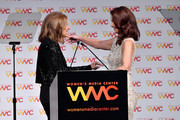 Gloria Steinem embraces Ashley Judd as she accepts the WMC Speaking Truth To Power Award onstage at the Women's Media Center 2017 Women's Media Awards at Capitale on October 26, 2017 in New York City.