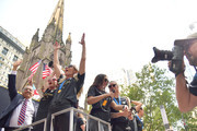 (L-R) United States Soccer Federation president Carlos Cordeiro, Megan Rapinoe, Allie Long, Alex Morgan and Ashlyn Harris celebrate while riding on a float during The U.S. Women's National Soccer Team Victory Parade down the Canyon of Heroes on July 10, 2019 in New York City. United States Soccer Federation president Carlos Cordeiro