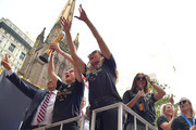 (L-R) United States Soccer Federation president Carlos Cordeiro, Megan Rapinoe, Allie Long and Alex Morgan celebrate and hold up the trophy while riding on a float during The U.S. Women's National Soccer Team Victory Parade down the Canyon of Heroes on July 10, 2019 in New York City. The team defeated the Netherlands 2-0 Sunday in France to win the 2019 Women's World Cup.