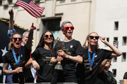 Ashlyn Harris, Alex Morgan, Megan Rapinoe, and Allie Long celebrate during the U.S. Women's National Soccer Team Victory Parade and City Hall Ceremony on July 10, 2019 in New York City.