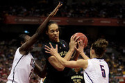 Center Brittney Griner #42 of the Baylor Bears is pressured by Tina Charles #31 and Caroline Doty #5 of the Connecticut Huskies during the Women's Final Four Semifinals at the Alamodome on April 4, 2010 in San Antonio, Texas.