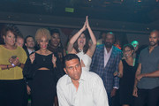 "Former professional basketball player Reggie Theus dances in a ""Soul Train line"" during the Coach Woodson Las Vegas Invitational red carpet and pairings gala at 1 OAK Nightclub at The Mirage Hotel & Casino on July 8, 2017 in Las Vegas, Nevada."